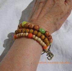 Bracelet élastique à trois rangs en perles indiennes perles de bois et céramique « Samantha » par Boutique Astrallia : http://www.alittlemarket.com/bracelet/fr_bracelet_elastique_a_trois_rangs_en_perles_indiennes_perles_de_bois_et_ceramique_samantha_par_boutique_astrallia_-15117705.html