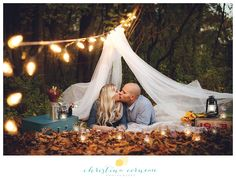 Christina Corneau Photography fall couples engagement session camping glamping mason jars strung lights tent woods