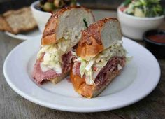 """The """"Barrett."""" Paper-thin shavings of Sy Ginsberg corned beef -- packed into a freshly baked onion roll with a scoop of creamy coleslaw, slice of Swiss cheese and a generous drizzle of Thousand Island dressing."""