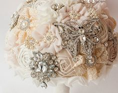This brooch bouquet has been sold, however, I will be delighted to create another one like it or in your own color scheme - Just send me a message with