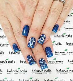 Galaxy inspired midnight blue nail art design. The midnight blue polish used is glitter polish to give out that starry night sky effect. White polish is also used for the artistic line details on top.