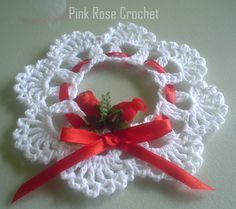 Best 12 Create an easy Crochet Wreath Ornament. Crochet ornaments are such wonderful free Christmas patterns. Crochet Christmas Wreath, Crochet Wreath, Crochet Christmas Decorations, Crochet Ornaments, Holiday Crochet, Xmas Ornaments, Crochet Crafts, Crochet Flowers, Crochet Projects