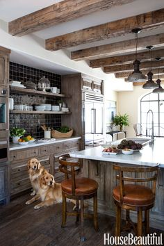To add a sophisticated note to the mellow charms of old wood in this Los Angeles, California, kitchen, designer Chris Barrett added black tiles, a vintage sink, and open shelves in the pantry.