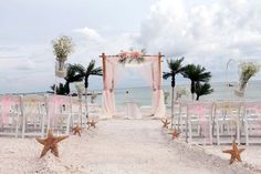 A sweeping aisle leads to a blush and champagne Island Oasis