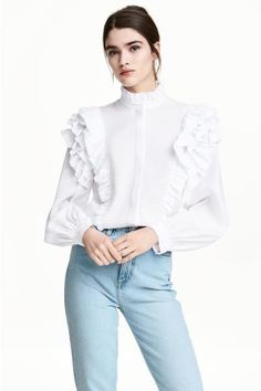 Blouse in an airy weave with a stand-up, frill-trimmed collar, concealed buttons down the front, frills on the shoulders and long, wide, cuffed sleeves.