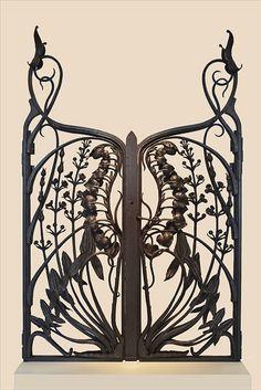 Grille Calla palustris et sagittaires réalisée vers 1902 par le ferronnier Emile Robert (Fer forgé Borderel et Robert) d'après un modèle de Victor Prouvé.