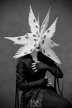 The Angelic Host by Phillip Valdez and Elisa Lazo @paperskullarts . Featured in the Netherlands this past summer at the CODA Museum for Paper Art  annual exhibition. Cut paper mask interpreting the many winged, many eyed seraphim. Gorgeous bustle coat by Kambriel.