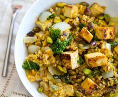 Pumpkin-Pistachio Kale Fried Rice Bowl with Maple Tofu Cubes.