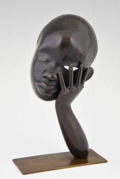 Bronze Head of an African Woman by Hagenauer, Vienna | From a unique collection of antique and modern bronzes at https://www.1stdibs.com/furniture/more-furniture-collectibles/bronzes/