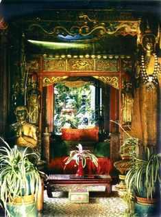 """""""An alcove in a bedroom at """"Dawnridge"""" circa 1980's decorated by Tony Duquette using carvings from South East Asia and some of his collections of bronze Thai Buddhas."""""""