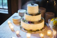 Three-Tier White Cake and Candles