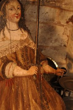 A 17th century dummy board depicting a woman holding a sword, possibly representing 'Vigilance', at Snowshill Manor, Gloucestershire. ©National Trust Images/Stuart Cox