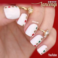 Linear Christmas Dotticure - This manicure will take less then 5 minutes to create ANNNNDD Doesn't it look like Santa's coats buttons!?!?  Full tutorial with helpful voiceover can be found on youtube