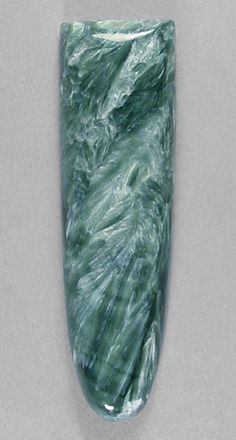 Me: photo was not labeled. I believe it's Seraphinite (not 100% positive). Called angels wings. It's green & creamy white swirling together. Great stone for Healing.  From Wiki: Seraphinite is a trade name for a particular form of clinochlore, (chlorite group) Seraphinite acquired its name due to its resemblance to feathers, such as one might find on a bird's wing. ...The word 'seraph' is from Isaiah 6 in the Hebrew Testament, and refers to winged angelic beings in service of God.