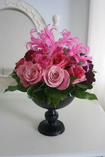 Ombre centerpiece of roses and nerine lilies.