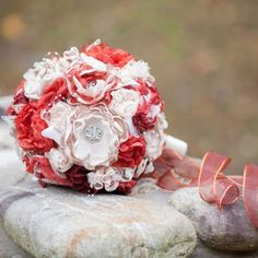 To match the sash on her dress, Jayna made a bouquet out of fabric flowers, lace, and sparkly silver pins. The bright red in the bouquet brings forth such an autumn feel.  image credit: Jean Moree Photography