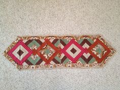 Quilt blocks into a table runner.