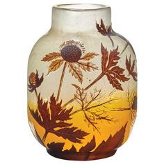 Galle Acid Etched and Fire Polished Cameo Glass Vase Circa 1900 Of flattened ovoid form, with a straight neck, in dark brown over colorless and frosted colorless and yellow glass, decorated with stylized blossoms, stems and leaves, cameo signed Galle. Height 6 1/8 inches