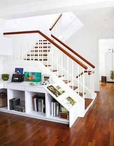 Skip the small table with small storage in front of the stair. This is attractive and has storage!
