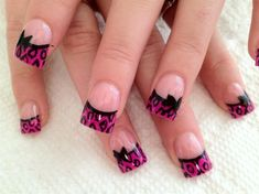 Pink and black leopard bow nail art
