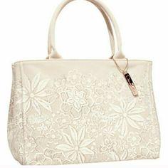 Neiman Marcus Oscar de la renta canvas bag Designer line for target.  Beautiful white floral design on canvas.  Perfect summer bag!! Oscar de la Renta Bags Totes
