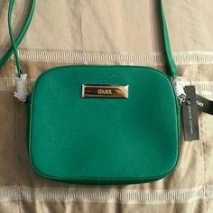DKNY green leather handbag Green (grass as indicated on the tag) DKNY bag..gold hardware.  Safiano leather super stylish! DKNY Bags Crossbody Bags