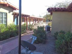 Looking along the front of the guest casitas today at Ghost Ranch Lodge. Foster held Anna in the last one down. First Down, The Fosters, Ranch, Arizona, Pergola, Clay, Outdoor Structures, Awesome, Guest Ranch