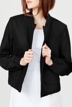 The essence of a chic city staple, our bomber is crafted in Italy from substantial Italian tropical wool. Its design is complete with a pronounced back box pleat and a gold push-stud detail at the nape of the neck. Add an interior leather patch with your monogram for an exceptionally unique, personalized touch. Slip its slightly cropped silhouette on for day or night to add edge to your aesthetic.