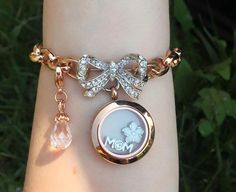 Chain link bracelet in rose gold, Pave Bouquet Clasp, med rose gold locket, and charms of choice.    Www.asaylor.origamiowl.com