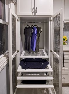 Custom Drying Cabinet for Laundry Room featuring pullout drying racks and a space to hang clothing to air dry