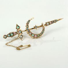 Willis was one of Australia's most prolific and famous jeweller that started business in 1858 and here is a magnificent antique opal brooch made by Willis around 1900.  Made in 15ct gold, the brooch is made in the form of a crescent moon and a sword which was a popular design from the Victorian times and as can be seen here should not be confused with the similar motif with a (curved) scimitar sword.  Set into the sword and the crescent moon are a total of 28 solid Australian opals that ...