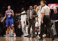 Head coach Avery Johnson of the Brooklyn Nets argues a call with the ref during the game against the Philadelphia 76ers at Barclays Center on December 23, 2012 in the Brooklyn borough of New York City.
