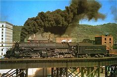 This enormous B&O EM-1 just crossed the Ohio River from Wheeling WV into Bellaire OH under a blue sky and a billow of smoke in the Spring of '57.