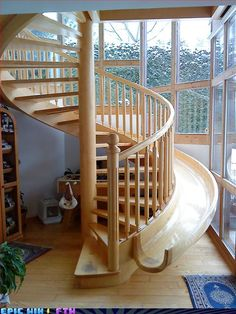 A slide...inside the house? Oh yeah. Maybe not the best idea right beside windows though.