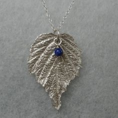 Check out Real raspberry leaf pendant, fine silver, lapis lazuli bead charm, on silverwindsjewellery