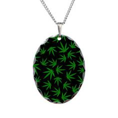 "Marijuana green leaves on black Necklace 1.2"" Pendant is made of aluminum and features a polished-scallop edge 18"" Brass necklace (with electroplated nickel, silver plating, finished with a non-tarnish overcoat gloss)"