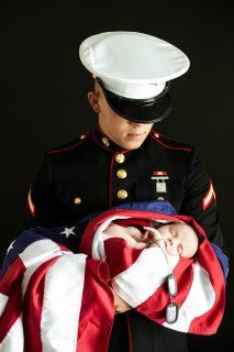Marine holding baby sister, breathtaking!