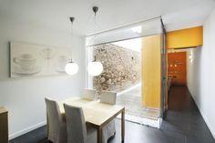 Una Casa Estrecha y Alargada con Toques Naranjas | Ideas Reformas Viviendas