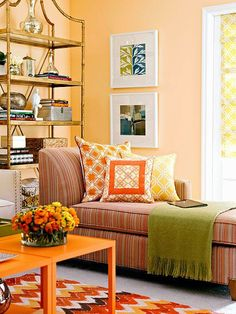 Connote cozy with more than just earthy hues. In this cheerful living room, a bouquet of oranges, from barely peach to blazing citrus, creates a cozy space with a modern edge! http://www.bhg.com/decorating/color/schemes/cozy-color-schemes-for-every-room/?socsrc=bhgpin010315&page=3