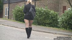 In my secretary outfit of ass revealing mini skirt, pantyhose tights and boots taking a walk to work.