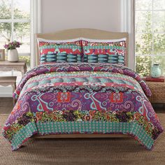 Zsa Zsa quilt set has a brightly colored patchwork cotton quilt. The patch work of floral patterns will give your room a cozy feel. The Zsa Zsa quilt has a cotton face and cotton fill with a soft texture. This quilt is machine washable.