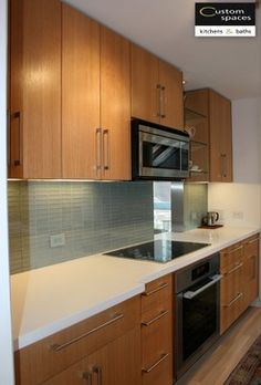 A sleek galley kitchen in #SF with beautiful finishes. Check out the glitzy glass #backsplash