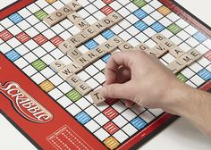 Scrabble is a word game that is played by forming words from individual lettered tiles on a game board.