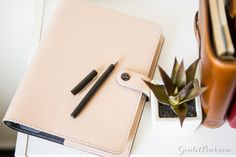 The Filofax Original Patent Organizer boasts a classic look perfect for the professional or creative planner. There are four bold but timeless colors available: Black, Fuchsia, Nude, and Purple. The left side of the notebook has a two pen elastic holder for slipping in your favorite Lamy CP1 and TWSBI.