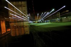 """This photo is a piece entitled """"Night Train""""  This is a shipment crate sitting on the tracks outside of an Atlanta crating facility. The photo was captured with a long exposure and slow pan of the lens. [Shot w/ Nikon d90]."""