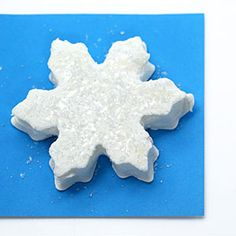 Brighten up the holiday table by cutting marshmallows into snowflake shapes and decorating with sparkling sugar.