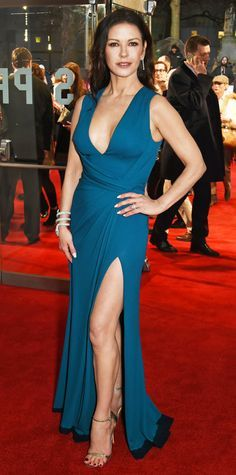 Catherine Zeta-Jones wowed at the world premiere of Dad's Army in a teal sleeveless deep-V high-slit Elie Saab gown that she styled with a serpentine coiled bracelet and metallic sandals.