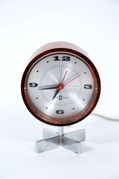 Arthur Umanoff; Rosewood and Steel Desk Clock for Herman Miller, 1950s.