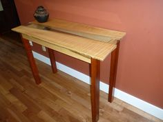 Side board to match dining room table.  Legs are zebra wood.