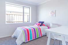 Add colourful bed throws to brighten up a room.